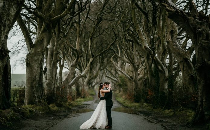 Northern Ireland elopement photographer, photo at the Dark Hedges, a road lined with amazing trees.