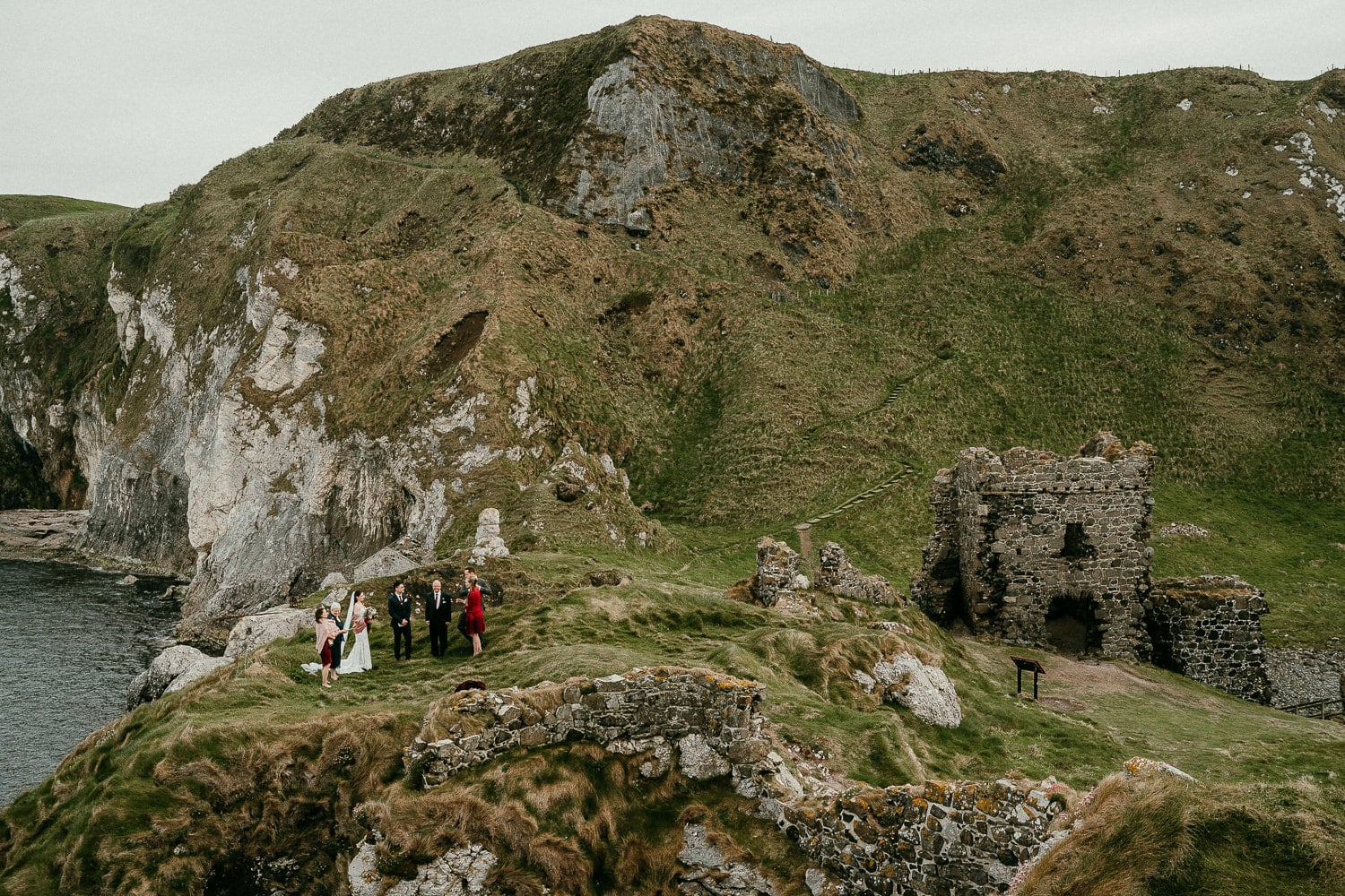 In small ceremony on a cliffs edge for an irish elopement