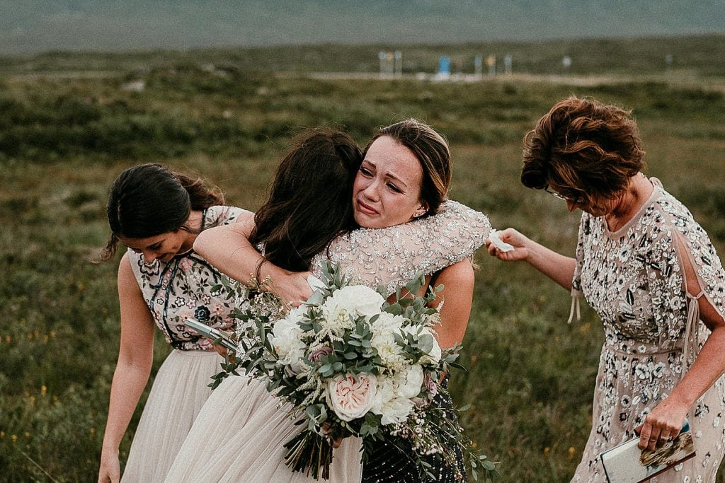 An emotional moment from a stunning ceremony location for a Scottish elopement. Scotland elopements. Adventure elopement in the Glencoe Mountains. Elopement Glen Coe