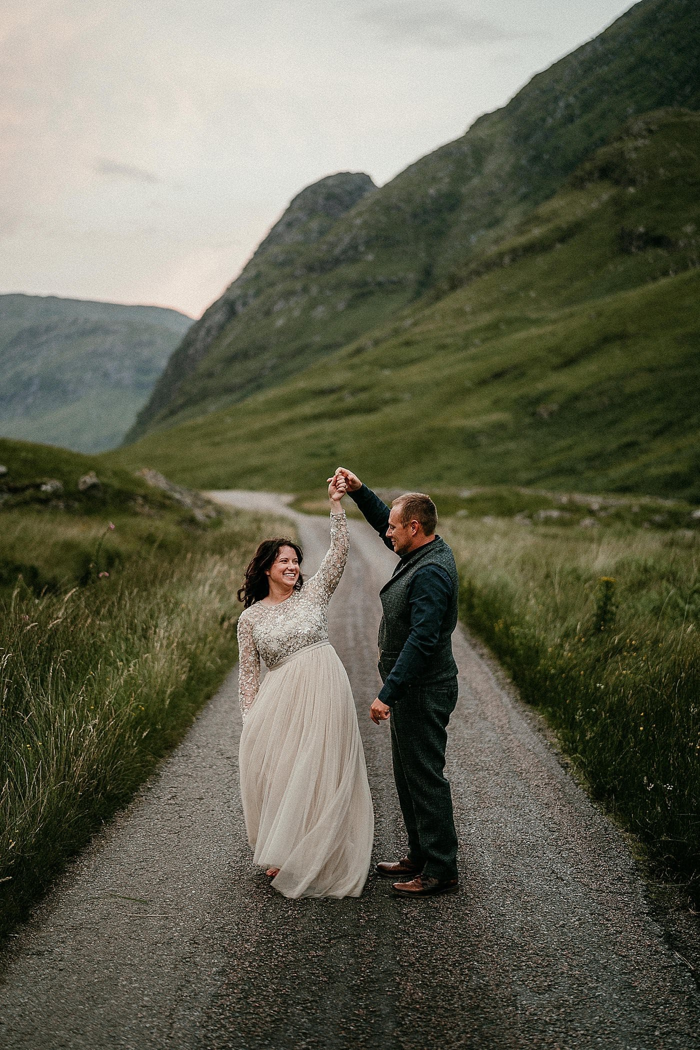 Bride & Groom dancing in The Highlands, it really make for a stunning location for a Scottish elopement. Scotland elopements. Adventure elopement in the Glencoe Mountains. Elopement Glen Coe