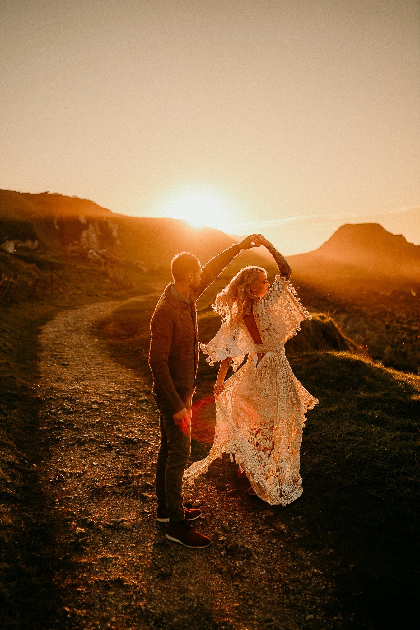 A couple dancing in the sunset. Adventure elopements in Northern Ireland. A romantic adventure session in Northern Ireland. Causeway Coast couples session. Northern Ireland couples sessions. Ireland elopement photographer.