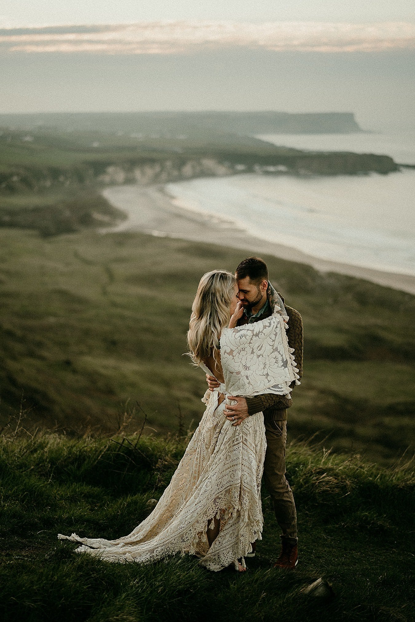 A sunset portrait in beautiful light on the Causeway Coast. Romantic adventure elopements in Europe. Dunseverick Castle.Adventure elopements in Northern Ireland. A romantic adventure session in Northern Ireland. Causeway Coast couples session. Ireland couples session. Ireland elopement photographer.