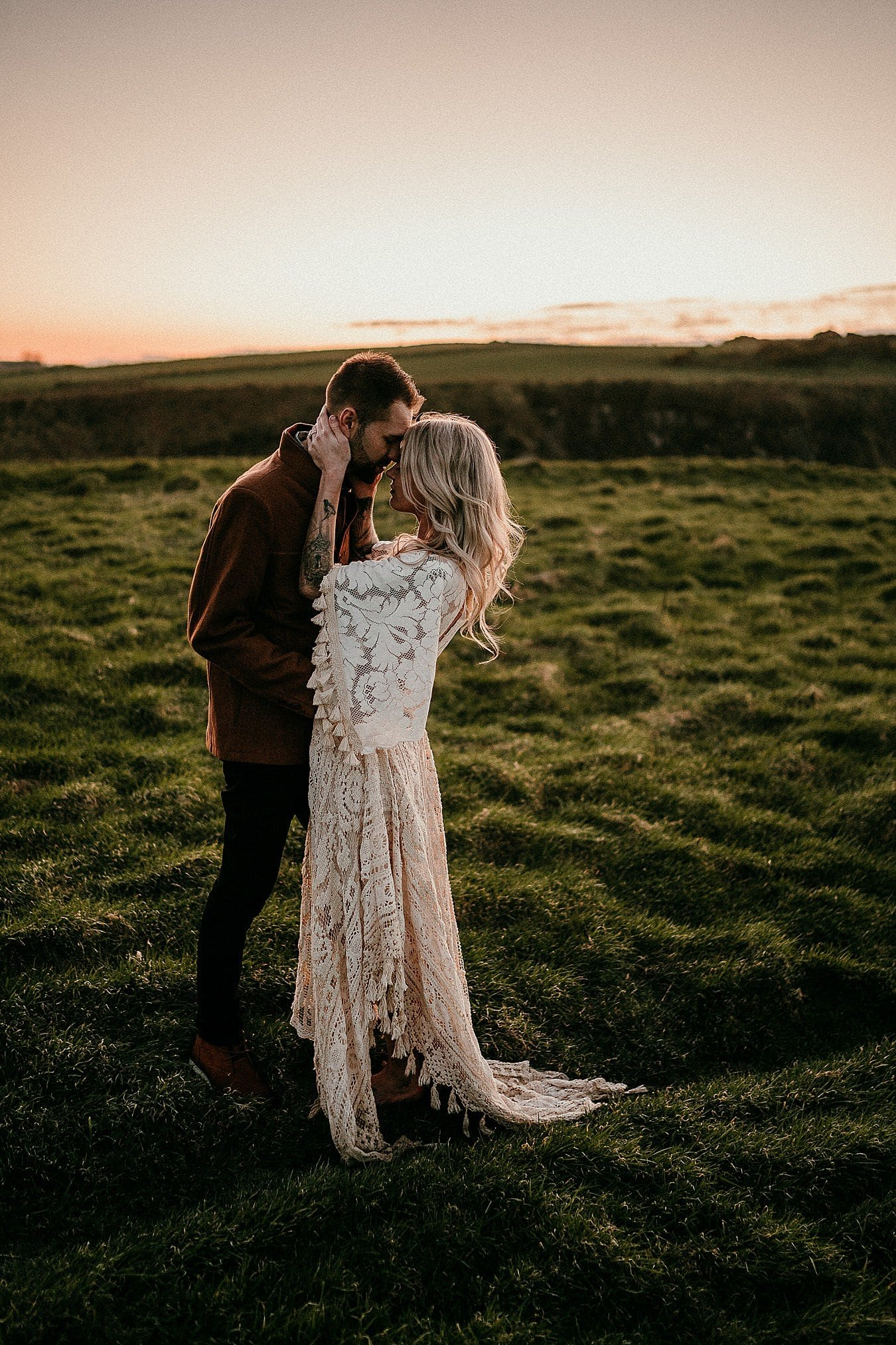 A sunset portrait in beautiful light on the Causeway Coast.Adventure elopements in Northern Ireland. A romantic adventure session in Northern Ireland. Causeway Coast couples session. Ireland couples session. Ireland elopement photographer.